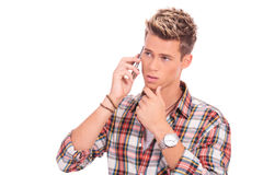 Pensive man on the phone Royalty Free Stock Images