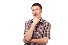 Pensive man in plaid shirt Stock Images