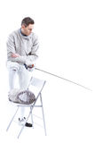 Pensive man professional fencer holding rapier and looking down Stock Photo