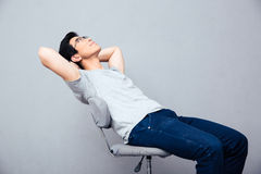 Pensive man relaxing on the chair Stock Photos