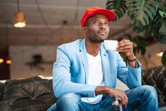 Pensive man resting with mug of beverage Royalty Free Stock Photos
