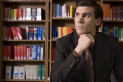 Pensive Man In Shirt And Tie At Library Stock Images