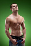 Pensive man shirtless looking up Stock Images