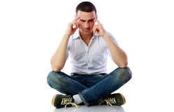 Pensive man sitting at the floor Stock Photography