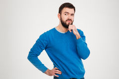 Pensive man. Standing isolated on a white background Royalty Free Stock Photos