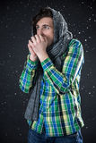 Pensive man standing with snow Royalty Free Stock Photography