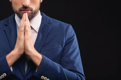 Pensive man thinking about his business. Concentrated young businessman is making serious decision. He is standing and joining hands.  and copy space in right Stock Image