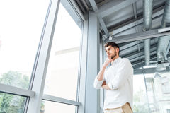 Pensive man thinking and looking at the window Stock Images