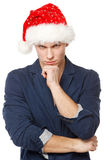 Pensive man wearing Santa hat Stock Photo
