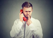 Man having dilemma during phone call stock images