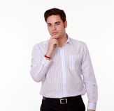 Pensive man on white shirt standing Stock Photos
