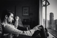 Pensive man by window Royalty Free Stock Photos
