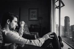 Pensive man by window