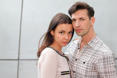 Pensive man and woman stand and look at camera Royalty Free Stock Image