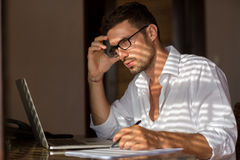 Pensive man working Stock Images