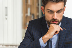 Pensive man working with concentration Stock Image