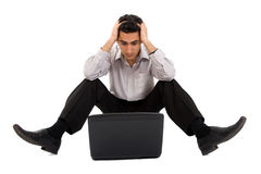 Pensive man working on laptop Royalty Free Stock Image