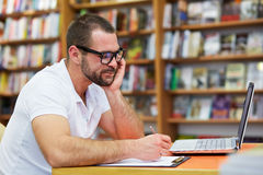 Pensive man working in the library Stock Photos
