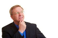 Pensive manager looking up Stock Photography