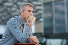 Pensive Mature Businessman Royalty Free Stock Images