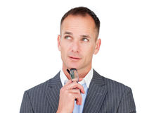 Pensive mature businessman holding glasses Royalty Free Stock Photography