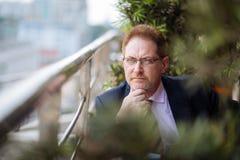 Pensive mature businessman Stock Photography