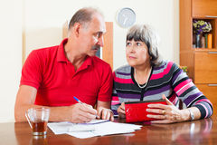 Pensive mature couple calculating family budget Stock Photo