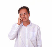 Pensive mature man with serious gesture Stock Photo