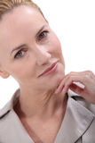 Pensive mature woman Stock Images