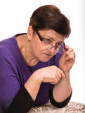 Pensive mature woman  with glasses Royalty Free Stock Photo
