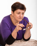 Pensive mature woman  with glasses Stock Photos