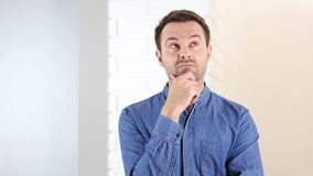 Pensive Middle Aged Man, Brainstorming. High quality Stock Photos
