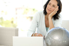 Pensive middle-aged woman royalty free stock image