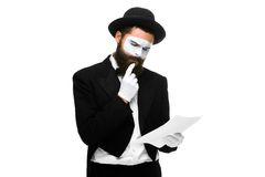 Pensive mime as a businessman reading the list of Royalty Free Stock Photos