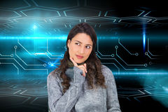Pensive model wearing winter clothes holding her tablet Royalty Free Stock Photo