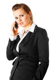 Pensive modern business woman with mobile phone. Pensive modern business woman  with mobile phone isolated on white Royalty Free Stock Images