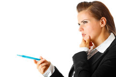 Pensive modern business woman  with pen Stock Images