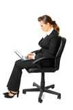 Pensive modern business woman using laptop Stock Images