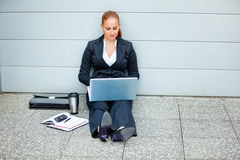 Pensive modern business woman using laptop Royalty Free Stock Photos