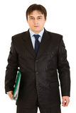 Pensive modern businessman holding folder Royalty Free Stock Image