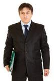 Pensive modern businessman holding folder Royalty Free Stock Image