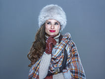 Pensive modern woman on cold blue looking on copy space royalty free stock images