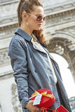 Pensive modern woman with shopping bags in Paris, France Stock Image