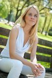 Pensive mood - woman on bench Royalty Free Stock Photo