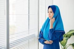 Pensive Muslim manager Stock Image