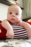Pensive newborn baby boy lying on a crawling roll Royalty Free Stock Photo