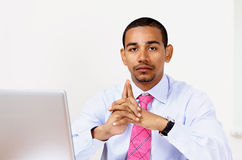Pensive office manager. Handsome ethnic office manager with pensive expression Royalty Free Stock Image