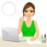Pensive office secretary woman working at the laptop Royalty Free Stock Photos