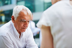 Pensive old business man Stock Photography