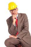 Pensive old construcion engineer sitting Royalty Free Stock Photo